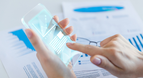 business, technology and people concept - close up of woman hand holding and showing transparent smartphone with chart on screen at office